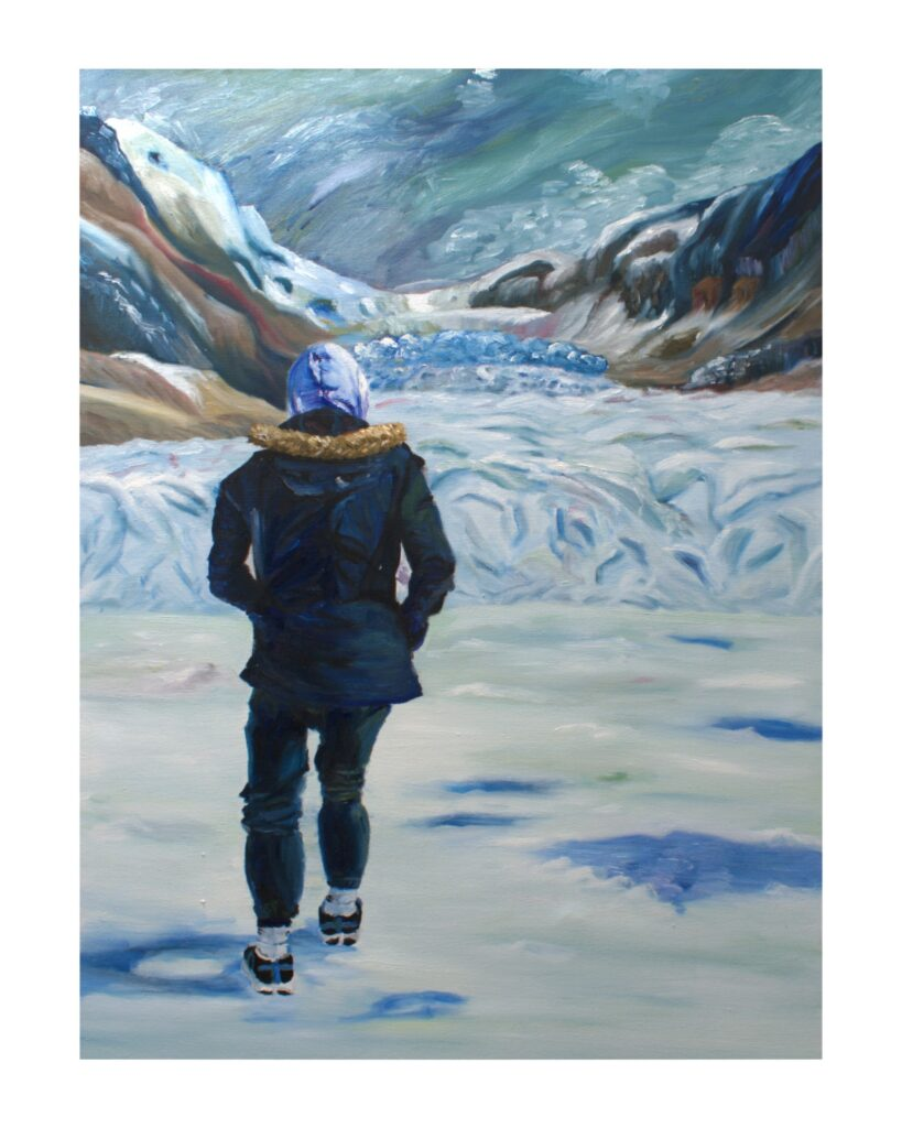 Hooded figure facing away from viewer into the icy mountains