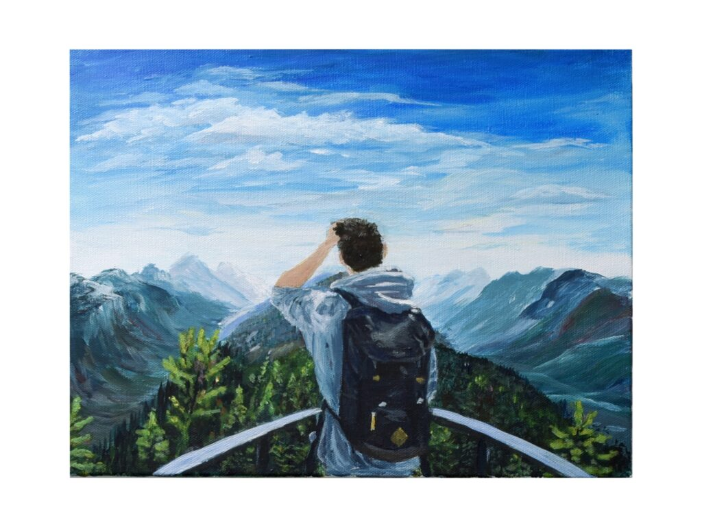 Male explorer looking out into the mountains